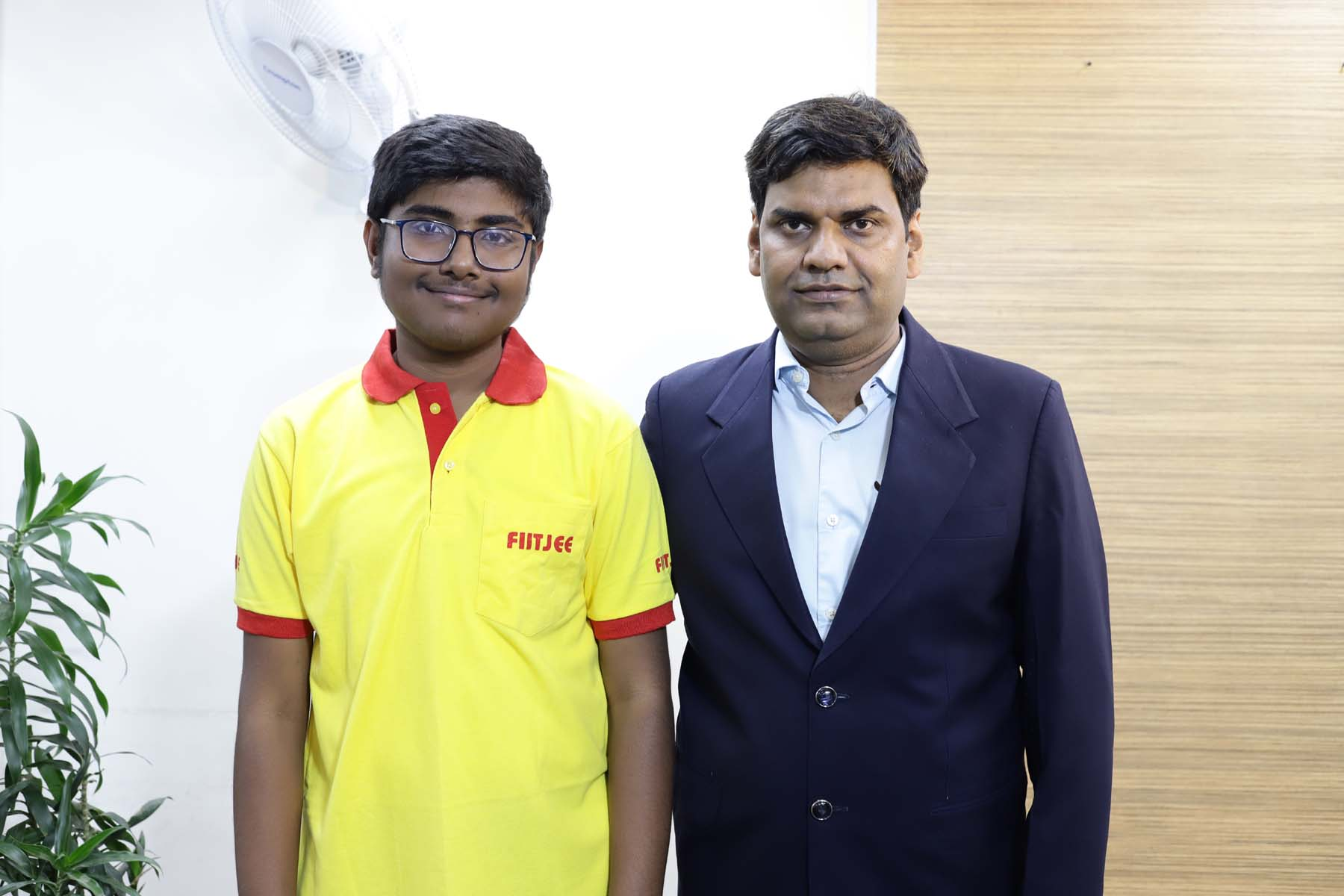 WORLD TOPPER_DHANANJAY RAMAN WITH TEACHER