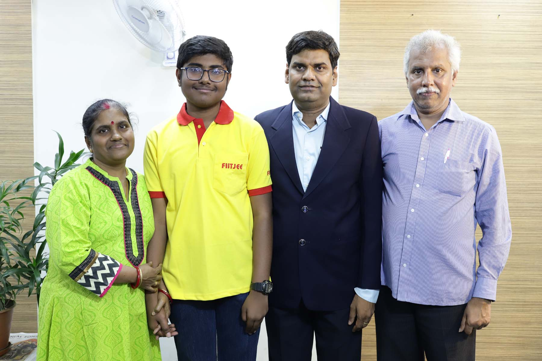 WORLD TOPPER_DHANANJAY RAMAN PARNENTS WITH TEACHER